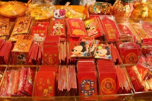 Red envelopes sold in markets in different designs.