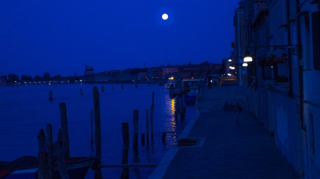 Photograph of a full moon over Venice, Italy. Thank goodness werewolves aren't nautical!  Photograph by Ryan Shields
